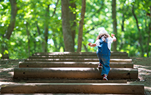 Young girl climbing steps
